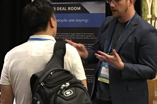 Josiah talking to an investor at Ultimate Partnering 2019 in Boston
